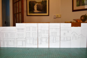 some buildings drawn on panels